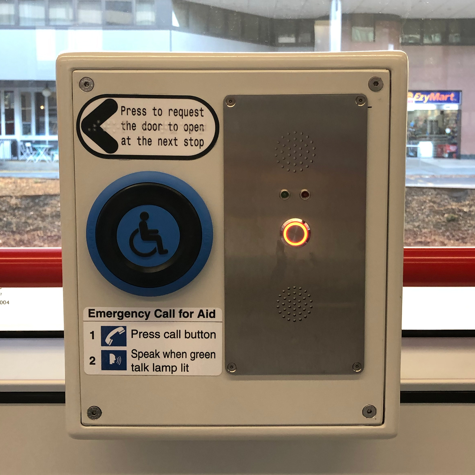Canberra Light Rail Tram help button with written text and braille